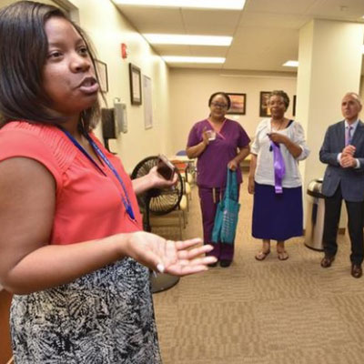 Chase Brexton's JaNee Deline leads a tour during the Glen Burnie Center Open House in April 2017.